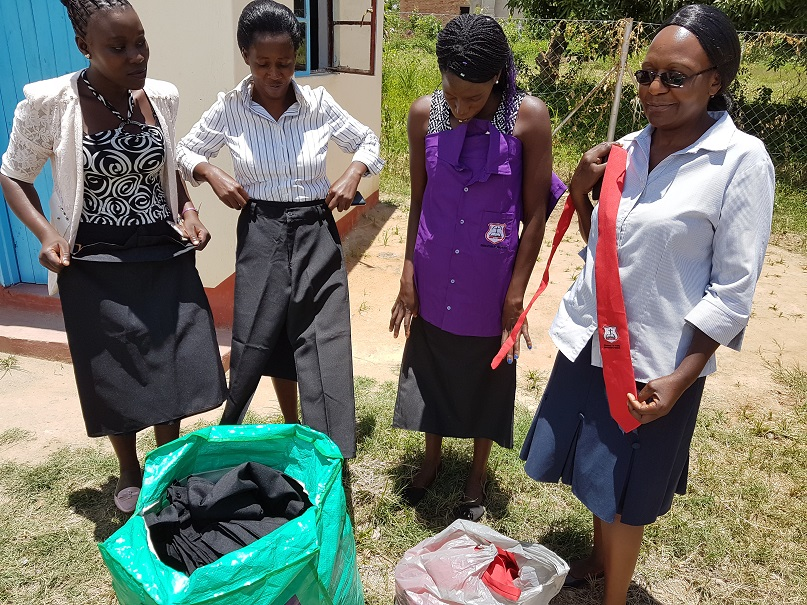 School staff sort new uniforms sent for the school